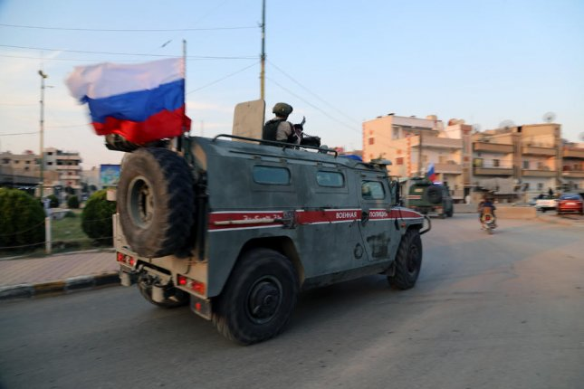 Russian military forces patrol an area in northern Syria on October 26, 2019. Officials said they joined Turkish troops for a patrol Wednesday along the M4 highway in Idlib province to monitor a cease-fire. File Photo by Ahmed Mardnli/EPA-EFE