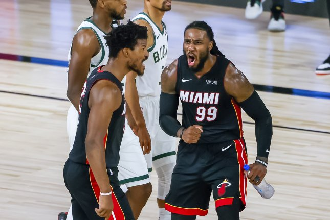 Miami Heat forward Jimmy Butler (L) celebrates after a dunk with teammate Jae Crowder (R) during the second half of Game 3 in their Eastern Conference semifinal series Friday night at the ESPN Wide World of Sports Complex near Orlando, Fla. Photo by Erik S. Lesser/EPA-EFE