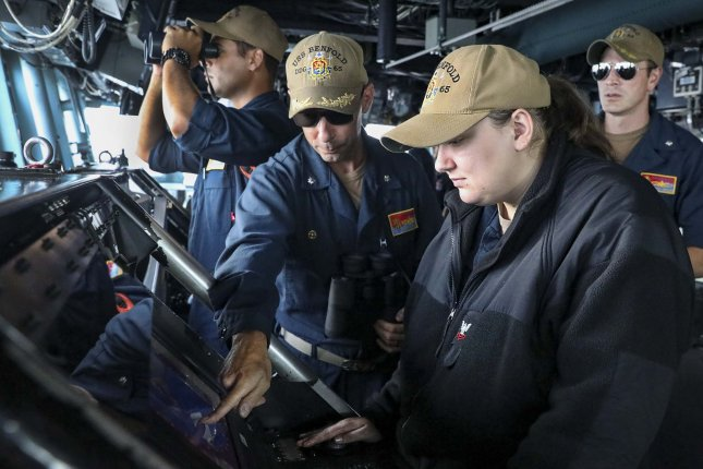 Operations Specialist 2nd Class Brittany Sopolosky monitors surface contacts from the bridge of the Arleigh Burke-class guided-missile destroyer USS Benfold as the ship transits the South China Sea on Wednesday. Photo by Mass Communication Specialist 1st Class Deanna C. Gonzales/U.S. Navy
