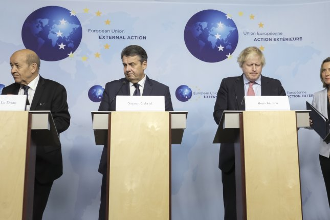 European foreign ministers apeak in Brussels, Belgium, after a meeting Thursday with Iranian Foreign Minister Javad Zarif. Photo by Olivier Hoslet/EPA