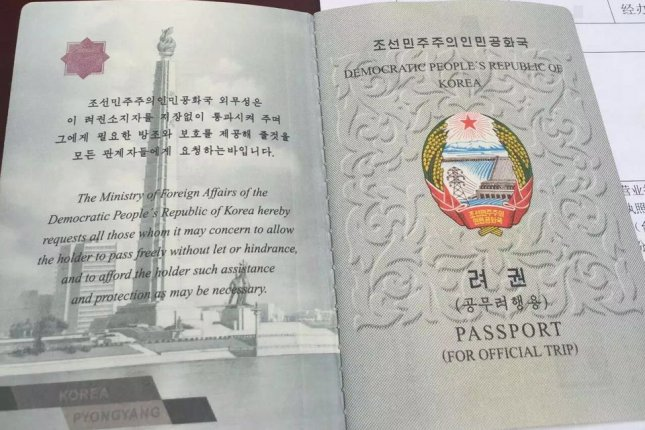 An undated picture made available on 14 April 2016 shows a passport and Chinese documents held by one of the 13 North Korean restaurant workers stationed in China who participated in a successful group defection to South Korea. File Photo by Yonhap/UPI.