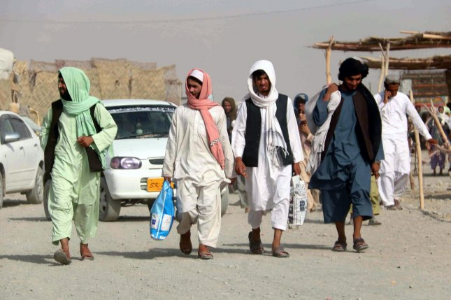 Civilians prepare to cross into Afghanistan through the Pakistani-Afghan border following the reopening of the border one day after the Taliban took control of the Afghan side, at Chaman, Pakistan, on July 15. Photo by Akhter Gulfam/EPA-EFE
