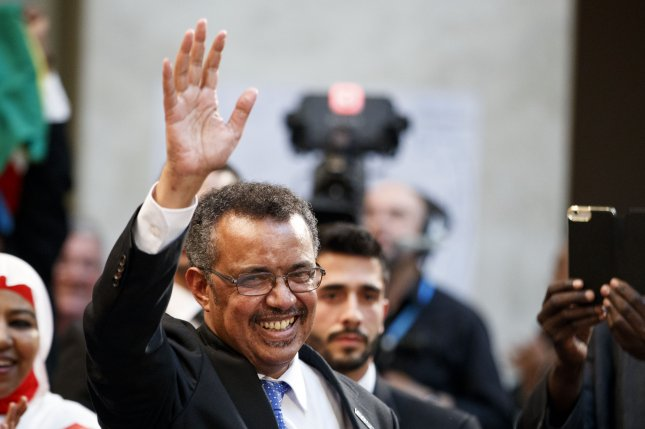 Tedros Adhanom Ghebreyesus of Ethiopia waves to the audience after being elected Director General of the World Health Organization (WHO) Tuesday during the 70th World Health Assembly at United Nations European headquarters in Geneva, Switzerland. Photo by Valentin Flauraud/EPA