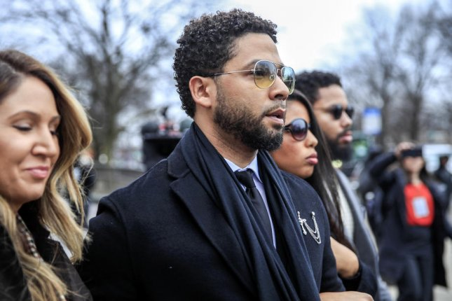 Actor Jussie Smollett (center) leaves a Chicago courthouse after pleading not guilty during his arraignment on felony charges of disorderly conduct on Monday. Photo by Tannen Maury/EPA-EFE