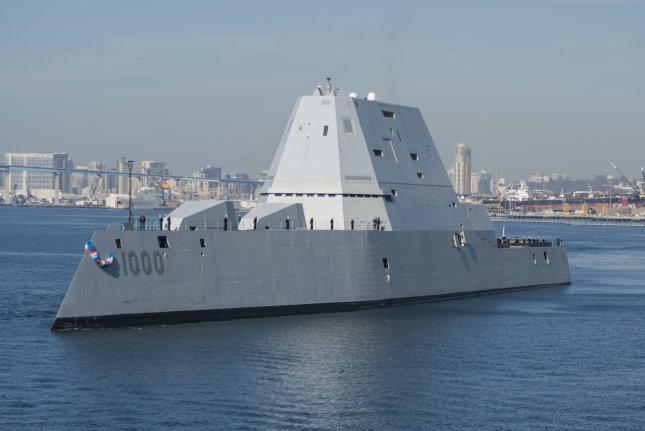 The guided-missile destroyer USS Zumwalt arrives at its homeport in San Diego. The Navy this week awarded contracts to Raytheon and Bath Iron Works for work on the class of ships. File Photo courtesy Petty Officer 3rd Class Emiline L. M. Senn/U.S. Navy
