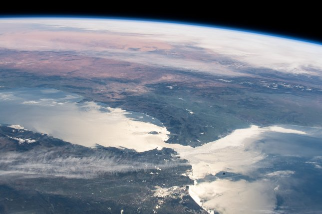 A combination of global warming and the collapse of the ozone layer preceded the mass terrestrial die-off that occurred 360 million years ago, called the Late Devonian extinction. Pictured, the Strait of Gibraltar, which connects the Atlantic Ocean with the Mediterranean Sea, as seen from the International Space Station. Photo courtesy of NASA