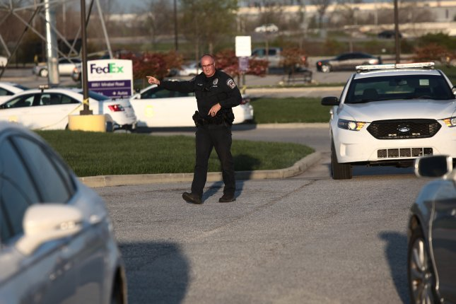 Indianapolis police guard Friday the entrance to a FedEx facility where a gunman had opened fire killing eight people and injuring several people before killing himself Thursday evening. Photo by Mark Lyons/EPA-EFE