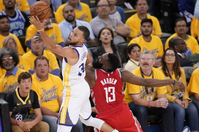 Golden State Warriors guard Stephen Curry (L) and Houston Rockets guard James Harden (R) fight for a loose ball during the second half of Game 3 of the Western Conference finals on Sunday at Oracle Arena in Oakland, Calif. Photo by John G. Mabanglo/EPA-EFE/Shutterstock