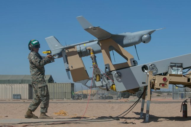 U.S. Marines with Marine Unmanned Aerial Vehicle Squadron One prepare to launch an RQ-21 Blackjack UAS during Weapons and Tactics Instructors Course 1-18 at Yuma, Ariz., on Oct. 13, 2017. Photo by Lance Cpl. Rhita Daniel/U.S. Marine Corps
