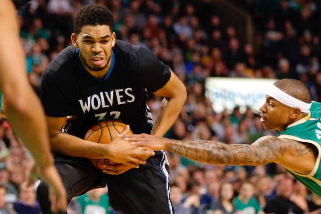Minnesota Timberwolves center Karl-Anthony Towns (L) hasn't played since Feb. 10 due to a fractured left wrist. Photo by C.J. Gunther/EPA