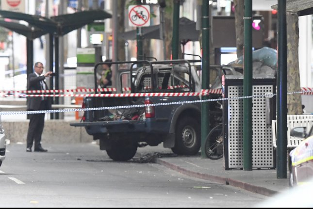 A burned truck is seen on Bourke Street in Melbourne, Australia, Friday. Authorities said a Somali man crashed the truck, set it afire and began stabbing people. Photo by James Ross/EPA-EFE