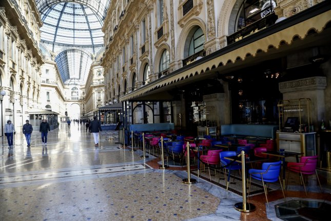 An empty restaurant in Galleria Vittorio Emanuele II amid the coronavirus emergency in Milan, Italy, on March 11. Photo by Mourad Balti Touati/EPA-EFE