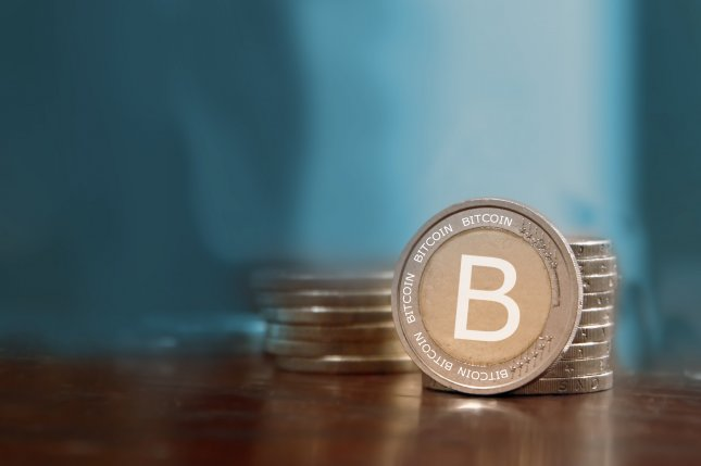 Bitcoin kicked off 2017 by breaching the $1,000 trading value milestone. Photo by Carlos Amarillo/Shutterstock