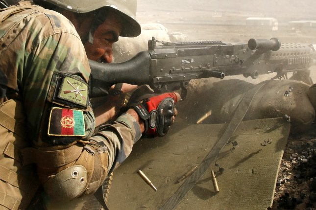 An Afghan national army soldier fires during a military maneuver Tuesday at the outskirt of Kabul, Afghanistan. A watchdog group reported 152 Afghan soldiers training in the United States have fled military bases and gone AWOL since 2005. File Photo by Jawad Jalali/EPA