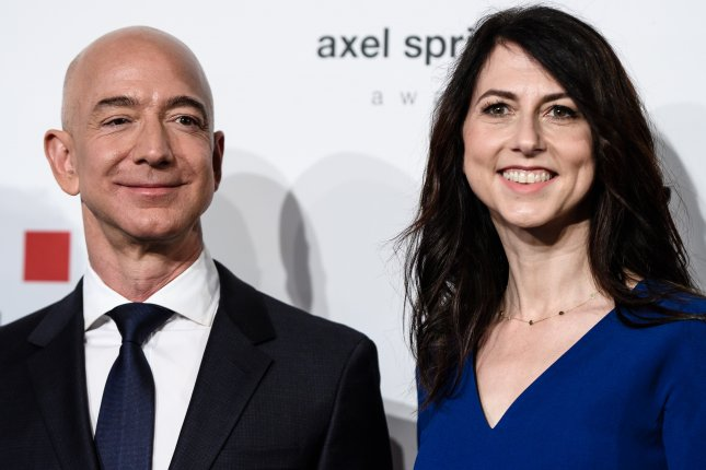 MacKenzie Bezos, shown with ex-husband Amazon CEO Jeff Bezos last year, is the wealthiest woman to sign onto the Giving Pledge, a commitment to give away the bulk of big fortunes. File Photo by Clemens Bilan/EPA-EFE