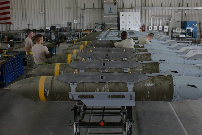 A 42-year-old airman assigned to Al Udeid Air Base, seen above, was found dead Saturday as a result of a non-combat related incident, the U.S. Department of Defense said. Maj. John D. Gerrie was from Kansas. A dozen 2,000-pound joint direct attack munitions sit inside a warehouse at Al Udeid Air Base, Qatar. Bombs are built by hand by airmen from the 379th Expeditionary Maintenance Squadron's Munitions Flight. Photo by Tech. Sgt. James Hodgman/U.S. Air Force/UPI