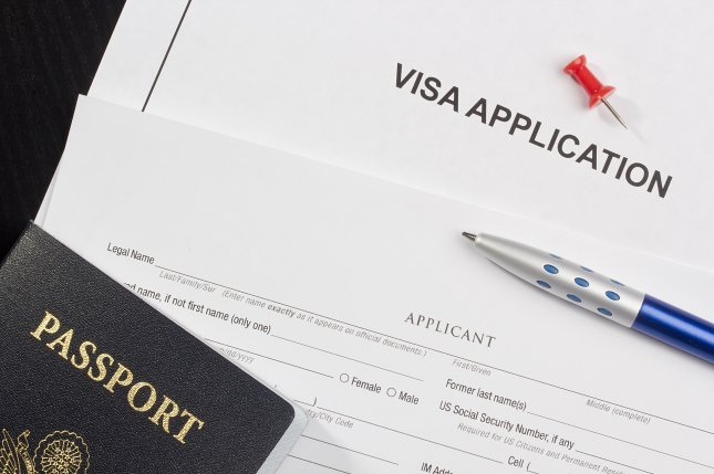 A visa application and passport, essential parts of how scientists move from country to country for collaboration on scientific research. File Photo by Constantine Pankin/Shutterstock