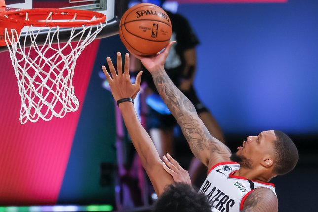 Portland Trail Blazers guard Damian Lillard (R) had a game-high 12 assists -- in addition to 42 points -- in a win over the Brooklyn Nets Thursday in Orlando, Fla. Photo by Erik S. Lesser/EPA-EFE