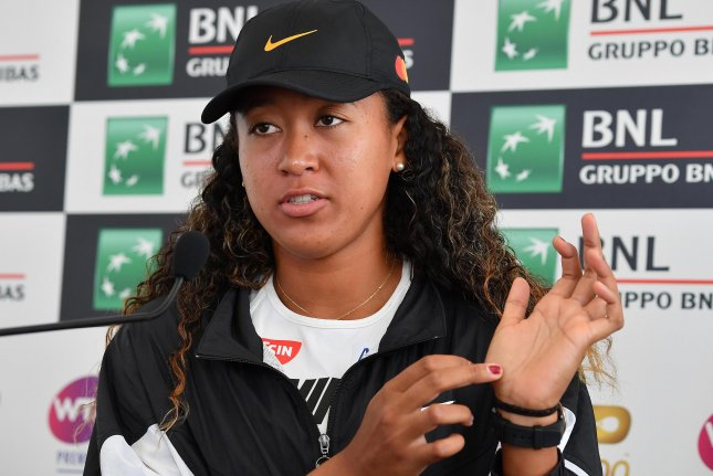 Naomi Osaka of Japan points to her injured thumb after withdrawing from the 2019 Italian Open on Friday in Rome. Photo by Ettore Ferrari/EPA-EFE