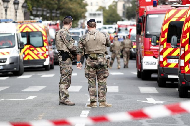 Military forces established a security perimeter near Paris police headquarters Thursday after a man was killed after stabbing to death four colleagues. Photo by Ian Langsdon/EPA-EFE