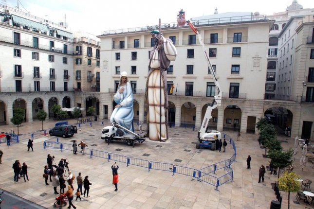 Technicians from an architectural firm measure the figures of the giant nativity scene in Alicante, in southeastern Spain, verify its status as the Guinness World Record holder for the world's tallest nativity scene. Photo by Morell/EPA-EFE