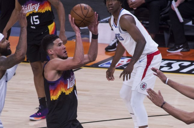 Phoenix Suns guard Devin Booker (1) shoots over a crowd of defending Los Angeles Clippers players in the first half during Game 1 of the 2021 NBA Western Conference Finals on Sunday at Talking Stick Resort Arena in Phoenix. Photo by Rick D'Elia/EPA-EFE