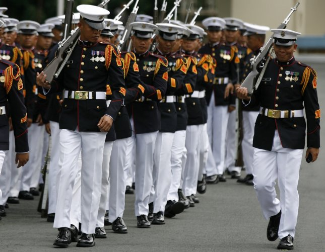 Filipino soldiers march after taking part in a ceremony on the burial of former dictator Ferdinand Marcos at the Heroes' Cemetery in Taguig City, south of Manila on November 18. Maria Serena Diokno, chairwoman of the National Historical Commission of the Philippines, announced her resignation Wednesday. Photo by Eugenio Loreto/European Pressphoto Agency