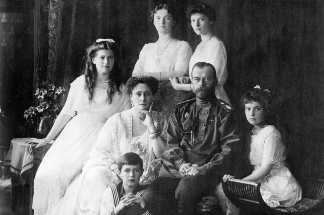 Photo shows members of the Romanovs, the last imperial family of Russia including: seated (left to right) Marie, Queen Alexandra, Czar Nicholas II, Anastasia, Alexei (front), and standing (left to right), Olga and Tatiana in 1913 or 1914. On February 6, 1928, a young woman claiming to be the slain Anastasia arrived in the United States. File Photo courtesy the Library of Congress