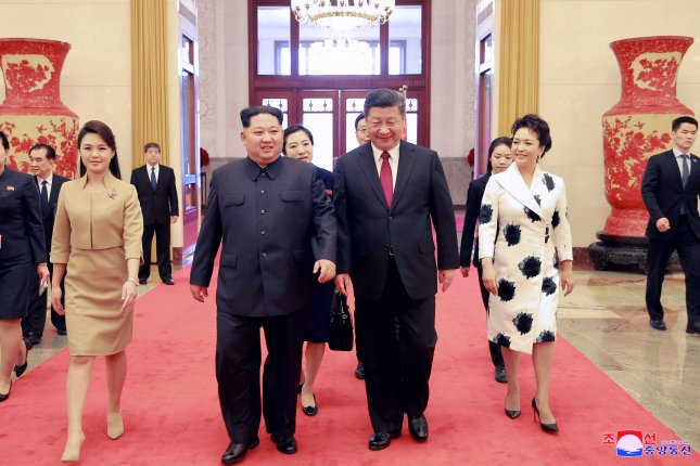 An undated photo released on 28 March 2018 by the North Korean Central News Agency (KCNA), the state news agency of North Korea, shows North Korean leader Kim Jong-un (C-L) and his wife Ri Sol-ju (L) walking with Chinese President Xi Jinping (C-R) and his wife Peng Liyuan (R) during their meeting in China. According to the North Korean media, Kim Jong-un visited China from 25 to 28 March at the invitation of Chinese President Xi Jinping. Photo by KCNA.