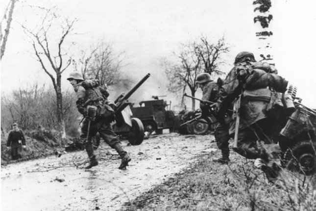 Panzergrenadier-SS Kampfgruppe Hansen in action during clashes in Poteau, Belgium, against Task Force Myers, on December 18, 1944, as part of the Battle of the Bulge. File Photo courtesy the U.S. National Archives and Records Administration
