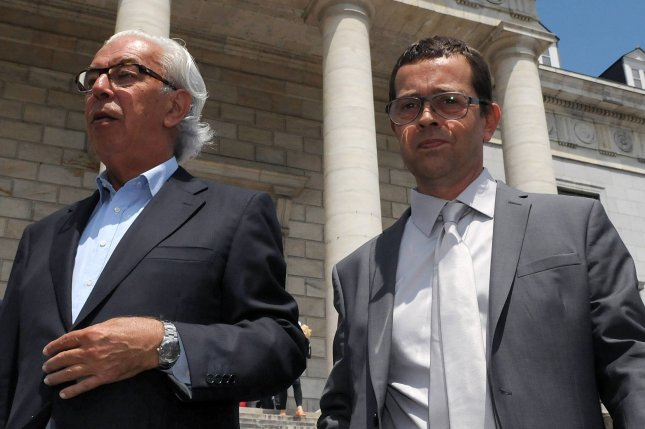 Former French doctor Nicolas Bonnemaison (R) arrives at court in Pau, France, in 2014. File Photo by Laissac Luke/EPA