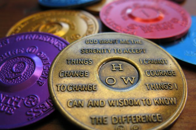 When combined, AA and 12-step clinical programs are more effective at maintaining sobriety than other approaches, a new study finds. These small sobriety tokens are given to members of 12-step programs. Photo by frankieleon/Wikimedia Commons