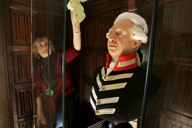 A waxwork head of Britain's King George III, cast from an original mould by Madame Tussauds, is prepared for display at Kew Palace in London in 2006. A new trove of papers belonging to George III are being released, showing his frustration at losing the American colonies. File photo by Richard Lea-Hair/EPA