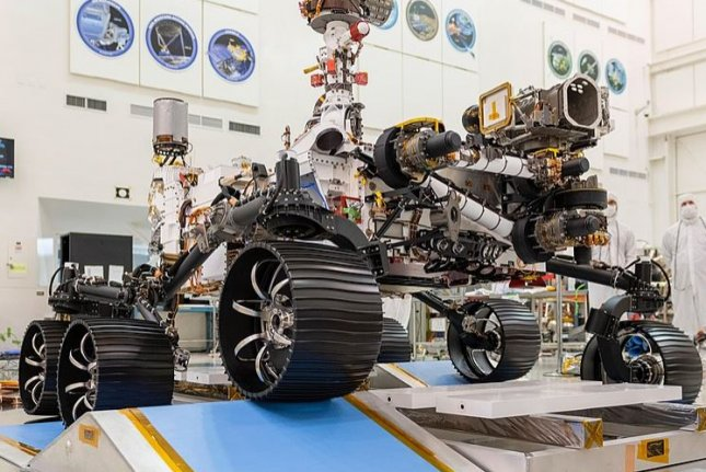 NASA's Mars rover Perseverance, which is scheduled to be launched July 17, towers over engineers during a 2019 driving test in California. Photo courtesy of NASA