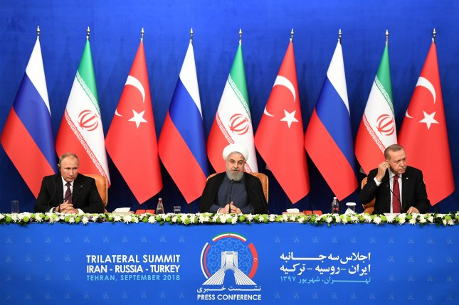 Iranian President Hassan Rouhani (C), Turkish President Recep Tayyip Erdogan (R) and Russian President Vladimir Putin (L) attend the press conference after meeting in Tehran, Iran, on September 7 to discuss Syria. Missing: the United States. Pool Photo by Kirill Kudryavtsev/EPA-EFE