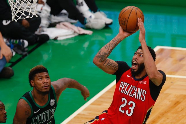 New Orleans Pelicans star Anthony Davis (23) makes a shot while defended by Boston Celtics forward Marcus Smart (L) on December 10 at the TD Garden in Boston. Photo by C.J. Gunther/EPA-EFE