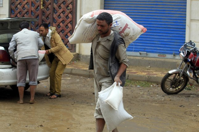 The World Food Programme said a Houthi-related organization meant to distribute food aid to civilians was instead selling at least some on the black market. File Photo by Yahya Arhab/EPA-EFE