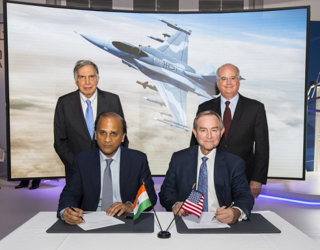 Sukaran Singh, chief executive officer of Tata Advanced Systems Limited, seated at left, and George Standridge, vice president of Strategy and Business Development for Lockheed Martin Aeronautics, sign a letter of intent to produce the F-16 Block 70 in India. Photo courtesy of Lockheed Martin