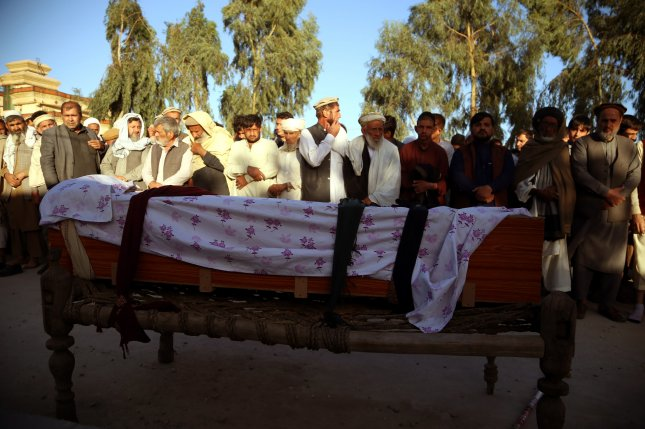 People attend the funeral of one of three female polio workers who were killed by gunmen during a polio vaccination campaign in Afghanistan. Photo by Ghulamullah Habibi/EPA-EFE