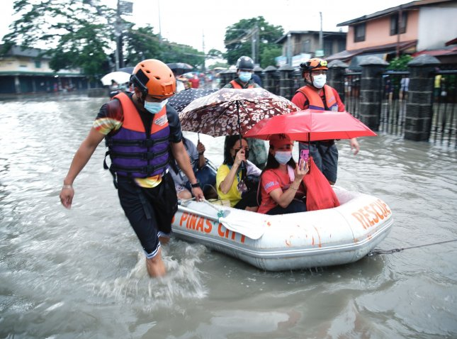 Filipino rescuers conduct rescue mission Satuday along a flooded road in Las Pinas city, Metro Manila, Philippines. Photo by Francis R. Malasig/ EPA-EFE