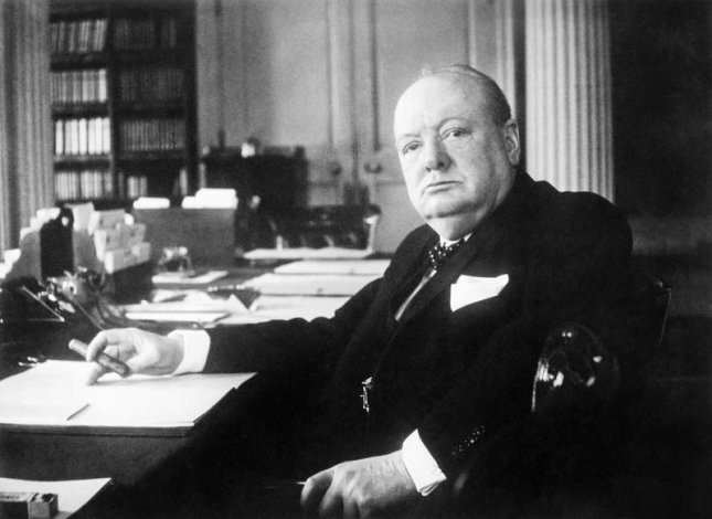 Portrait of Prime Minister Winston Churchill at his seat in the Cabinet room at No. 10 Downing Street, London. File Photo courtesy Cecil Beaton/Imperial War Museums