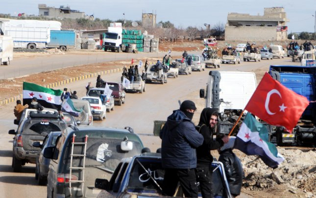Turkish military and the Free Syrian Army launched a land operation to cross the border into the Syrian province of Afrin on Sunday morning. Photo by Hasan Kirmizitas/EPA