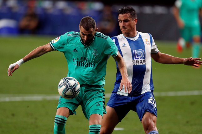 Real Madrid's Karim Benzema (L) provided a nutmeg assist at the end of the first half of a game against Espanyol Sunday at RCDE Stadium in Barcelona. Photo by Alberto Estevez/EPA-EFE