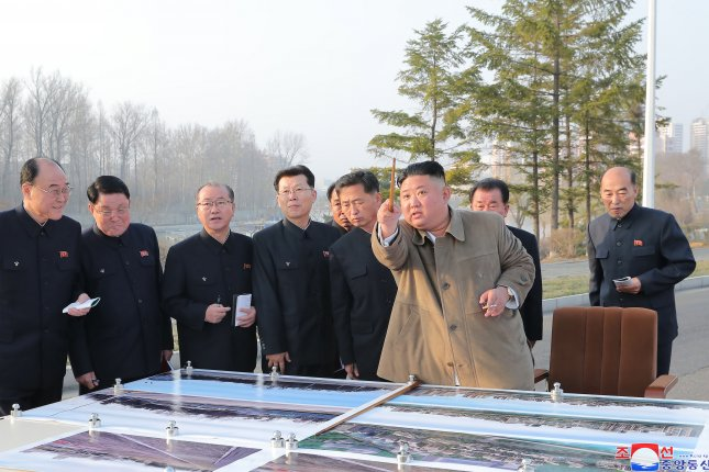 North Korean leader Kim Jong Un (front) broke ground at a site in Pyongyang for apartment construction Tuesday. File Photo by KCNA/EPA-EFE