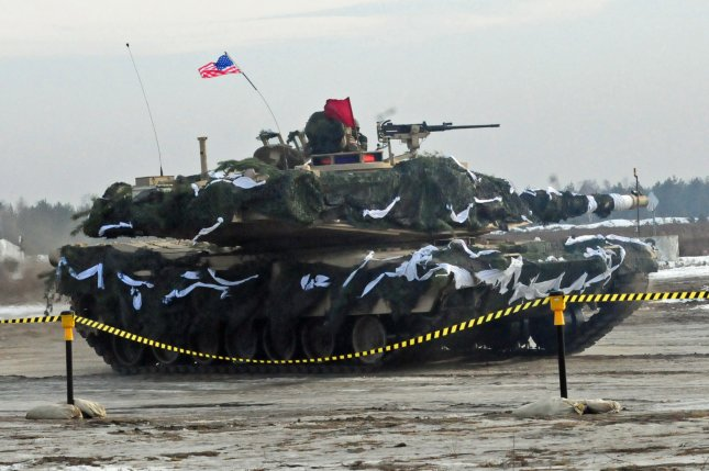 An American Abrams Tank moves into firing position during a live-fire training exercise with NATO allies on January 30 at Karlikie Range, Zagan, Poland. Security expert Michael O'Hanlon said barring any further nations from joining NATO might ease tensions with Russia. File Photo by Staff Sgt. Corinna Baltos/U.S. Army/UPI