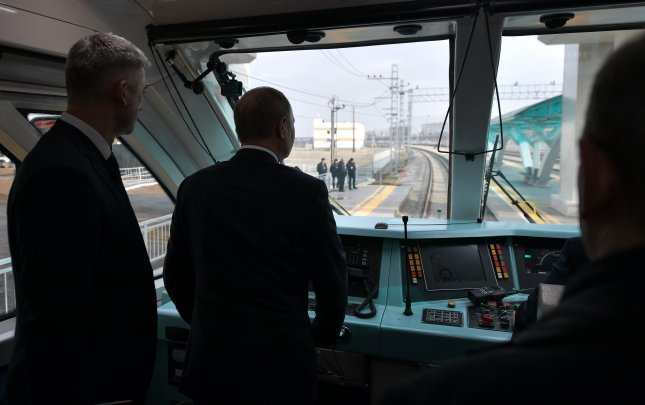 Russian President Vladimir Putin (2-L, back to camera) travels aboard a rail-bus from Kerch to Taman before the opening ceremony of the railway part of the Krymsky (Crimean) Bridge over the Kerch Strait, Crimea, Dec. 23, 2019. Photo by Alexey Nikolsky/EPA-EFE/SPUTNIK/ KREMLIN POOL