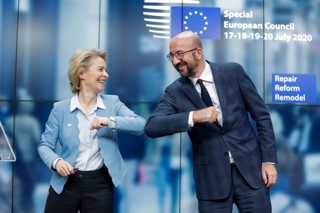 European Commission President Ursula Von Der Leyen (L) and European Council President Charles Michel give one another an elbow at the end of a news conference following a four-day European summit at the European Council in Brussels on Tuesday. Photo by Stephanie Lecocq/EPA-EFE