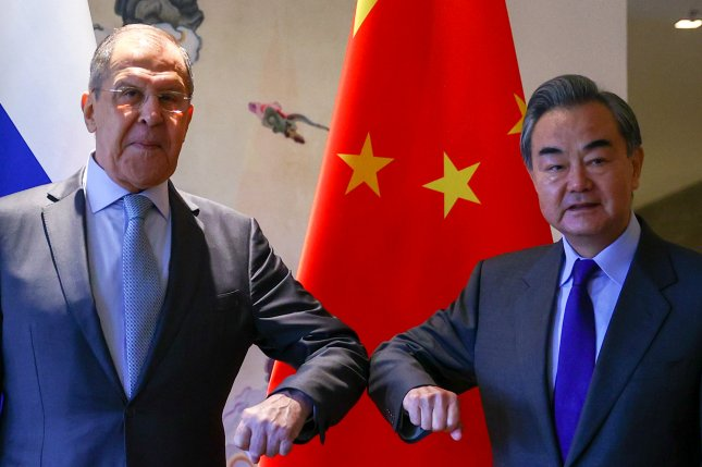 Russian Foreign Minister Sergei Lavrov (L) and Chinese Foreign Minister Wang Yi (R) pose for a photograph during their meeting in Guilin, China, on March 23. Photo courtesy of Russian Foreign Affairs Ministry/EPA-EFE