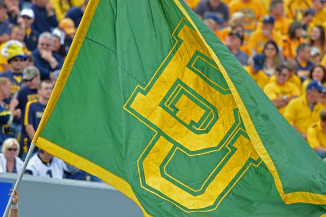 A former Baylor University student filed a Title IX lawsuit against the school on Friday, alleging that she was raped by football players after a party in 2013 and that her claims were neglected. The suit also alleges that 52 acts of rape involving at least 31 football players occurred at the school between 2011 and 2014. File Photo by Aspen Photo/Shutterstock