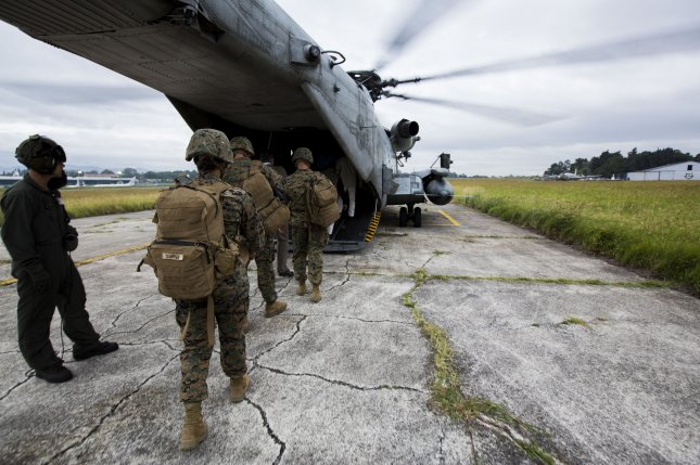 U.S. Marines with the Special Purpose Marine Air-Ground Task Force-Southern Command board a CH-53 Super Stallion in Guatemala City, Guatemala, in 2015. Photo by Cpl. Katelyn Hunter/U.S. Marine Corps